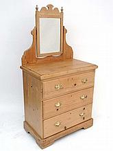 A late Victorian stripped pine dressing chest comprising mirror over three graduated long drawers . 30
