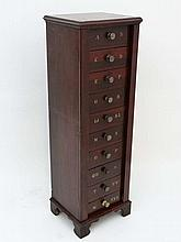 A 19thC mahogany collectors/ filing cabinet of Wellington form having 10 drawers with divisions labelled A - Z with bras