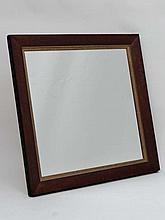 A Contemporary mahogany veneerer wall mirror with gilt slip . the whole 30 3/4