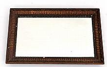 A c.1900 hanging wall mirror with beaded and acanthus framed border bears remains of period label verso for 'Davis Berke