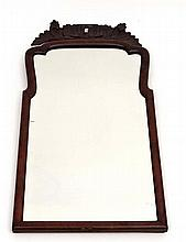 A c.1900 Queen Anne style bevelled edged wall mirror with cushion moulding and carved top crest 24