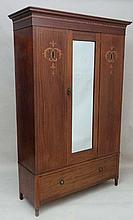 An Edwardian inlaid and strung mahogany double wardrobe with central bevelled edge mirror to door over single drawer 50