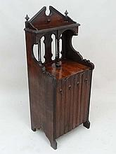 Gothic Revival : A 19thC walnut music cabinet, unusually having four fall front sections for music etc. 45