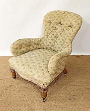A Victorian button back low arm over stuffed chair with iron frame? and short golden oak legs. 34