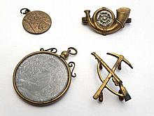 Militaria : A selection of early 20thC military items , comprising a Labour ( later Pioneer ) Corps collar badge , a Kin