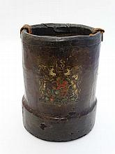 Militaria : A c1900 short Cordite carrier , cylindrical form with leather over cork construction , the Monarch's coat of