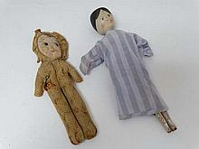 A late 19th C peg style doll with painted hair and face, and jointed legs. In fabric nightshirt. 12 1/2'' high.  Togethe