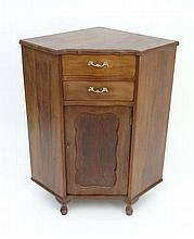 A Continental walnut corner cabinet comprising 2 drawers over a cupboard door and standing 36 1/4