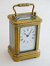 Miniature Carriage Clock : a 5 bevelled glass , brass cased miniature carriage ( timepiece) clock , the enamel dial  wit