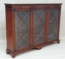 A Contemporary mahogany glazed fronted floor standing triple bookcase 11 1/2