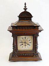 Junghans Mantle Clock : a late 19 thC Architectural Walnut cased 8 day mantle clock with signed silvered 6