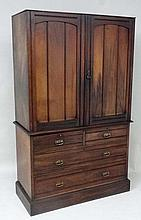 Maples & Co : A late Victorian linen press on chest, the two door top opening to reveal 4 linen slides within over a bas