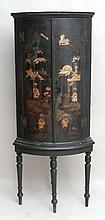 An early - mid 19thC green lacquered bow front corner cabinet with chinoiserie decoration on 4 ring turned legs 56