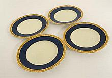 A set of 4 Copeland Spode plates with blue border and tooled gilt floral detail to rim. Factory stamp to base. 9'' diame