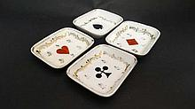 A set of four hand painted porcelain bridge dishes decorated with the card suits and gilt details. 3 1/2'' x 3''.  P