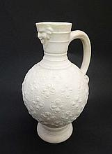 A Minton Parian ware Jug with mask spout with moulded quatrefoil scallop decoration to body. Late 19th/early 20th C. Min