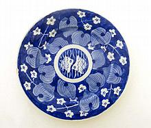 A small Chinese blue and white ceramic plate. Decorated with floral and foliate images. Indistinct Chinese character mar