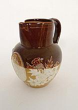 A Royal Doulton 2-tone stoneware jug commemorating Queen Victoria's Golden Jubilee in 1887, and decorated with applied u