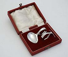 A cased christening set comprising spoon and pusher hallmarked Sheffield 1953 maker Oliver & Bower Ltd  Please Note