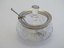 A cut glass preserve pot with silver rim hallmarked London 1928 maker Henry Perkins & Sons. With associated preserve spo