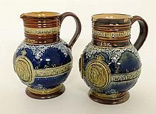 A Pair of Royal Doulton Lambeth stoneware commemorative jugs. Commemorating the Diamond Jubilee of Queen Victoria. With