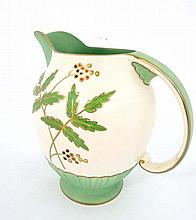 A Crown Devon Fieldings jug. In green and cream with leaves and berries design. Crown Devon mark to base together with M