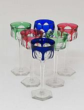 A set of 5 Bohemian hock glasses, the coloured bowls with clear tapering hexagonal stems on clear glass hexagonal feet.