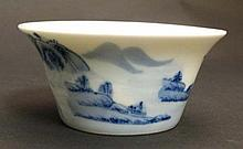 A small Chinese blue and white porcelain bowl. Decorated with an oriental landscape including boats and figures. Six Chi