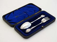 A cased silver Christening set comprising silver spoon and fork . Hallmarked Sheffield 1903 maker Thomas Bradbury & Sons