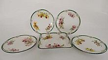 A set of four 'Royal Doulton Plates and a sweet meat dish in the ''orchid '' pattern. Green factory mark for 1902-1922.