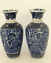 A Pair of blue and  white Japanese style Imari porcelain vases. Decorated with images of storks and foliage. 18'' high