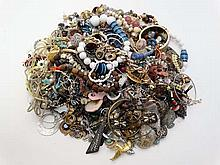 A very large quantity of assorted costume jewellery to include bracelets, necklaces etc  Please Note -  we do not ma