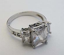 A white gold ring marked 10kt set with white stones   Please Note -  we do not make reference to the condition of lo