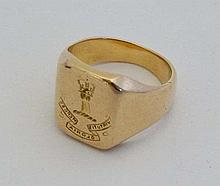 An 18ct gold signet ring having seal to top depicting a family armorial and motto (14g)  Please Note -  we do not ma