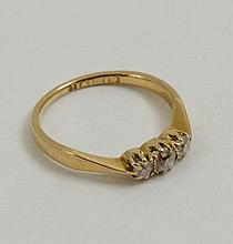 An 18ct gold ring set with trio of diamonds   Please Note -  we do not make reference to the condition of lots withi