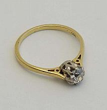 An 18ct gold ring set with central diamond   Please Note -  we do not make reference to the condition of lots within