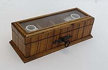 An Unusual 19thC continental glazed top travelling writings et, the bevelled glass hinged lid opening to reveal 2 square