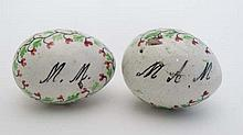 Hand painted marriage eggs Ceramic marriage eggs ; a pair of hand painted ceramic eggs having floral and foliate decorat