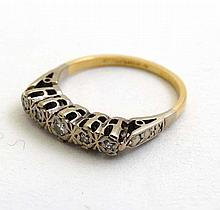 An 18ct gold ring set with 5 graduated diamonds in a linear setting   Please Note -  we do not make reference to the