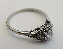 A platinum diamond solitaire ring, the central diamond flanked by 3 chip set diamonds to each shoulder.   Please Not