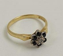 An 18ct gold ring set with central diamond bordered by 6 diamonds  Please Note -  we do not make reference to the co