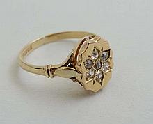 A 9ct gold ring set with 7 diamonds to top   Please Note -  we do not make reference to the condition of lots within