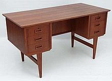 Vintage Retro : A Danish Teak Desk having two 3 drawer pedestals supported by 4 tapering legs with o