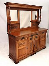 A late 19thC oak mirror back sideboard with bevelled mirrors over a base of 4 drawers and 4 cupboard