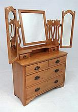 A late 19thC Arts and Crafts dressing table with 2 arch shaped hinged mirrors and central squared mi