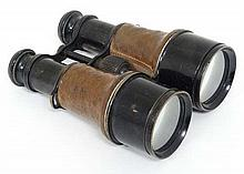 Militaria : A pair of Army Officer's binoculars , likely WWI era . Brass outer  with leather grips ,