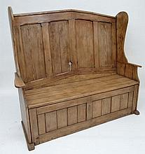 An 18thC Artisan made panelled settle with four panel back, shaped wings and arms. Approx 61