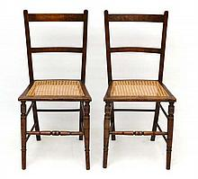 A pair of stained beech caned seated bedroom chairs. each standing 33
