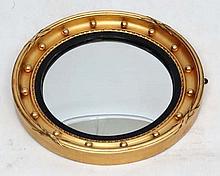 An early 0thC gilt shaped convex gunshot mirror 16 1/2