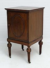 An early 20thC French mahogany pot cupboard with beaded decoration and carved and reeded legs 16 1/2